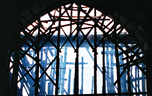 arched window with impression of crosses